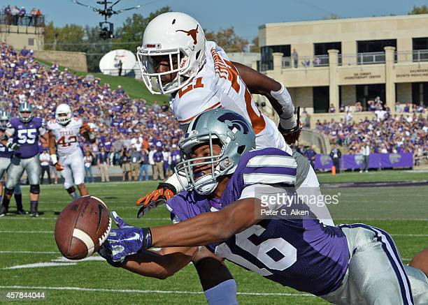 Wide receiver Tyler Lockett of the Kansas State Wildcats makes a diving attempt for a pass against defensive back Duke Thomas of the Texas Longhorns...