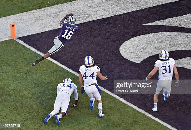 Wide receiver Tyler Lockett of the Kansas State Wildcats rushes in for a touchdown against the Kansas Jayhawks during the first half on November 29,...