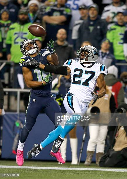 Wide receiver Tyler Lockett of the Seattle Seahawks can't hold on to a catch against cornerback Robert McClain of the Carolina Panthers at...