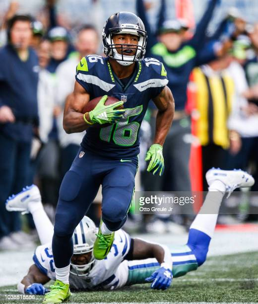Wide Receiver Tyler Lockett of the Seattle Seahawks catches a pass for a score during the 2nd quarter against the Dallas Cowboys at CenturyLink Field...