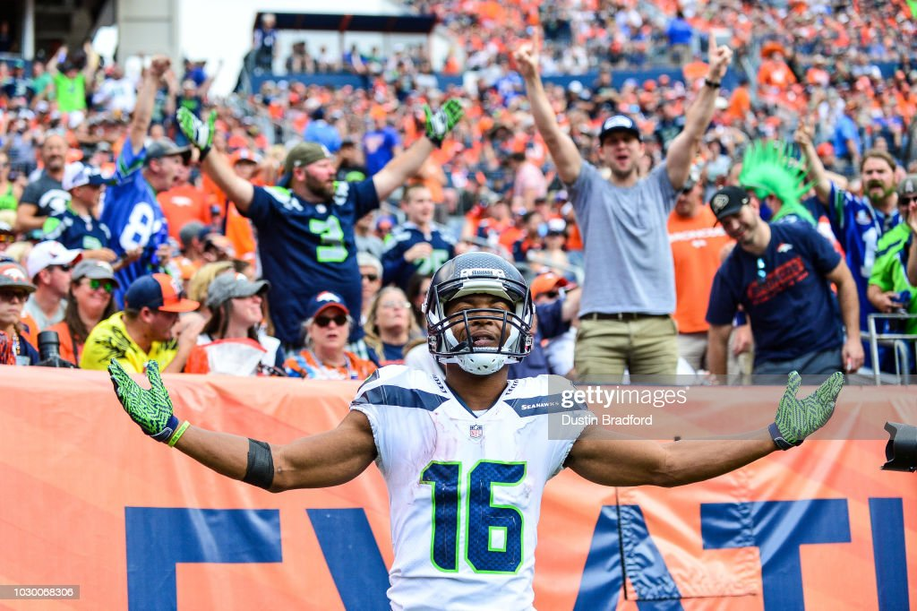 Wide receiver Tyler Lockett #16 of the Seattle Seahawks celebrates after scoring a fourth quarter touchdown under coverage by defensive back Justin Simmons #31 of the Denver Broncos at Broncos Stadium at Mile High on September 9, 2018 in Denver, Colorado.