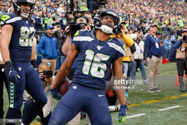 Wide receiver Tyler Lockett of the Seattle Seahawks celebrates after scoring a touchdown against the Tampa Bay Buccaneers in the first quarter at...