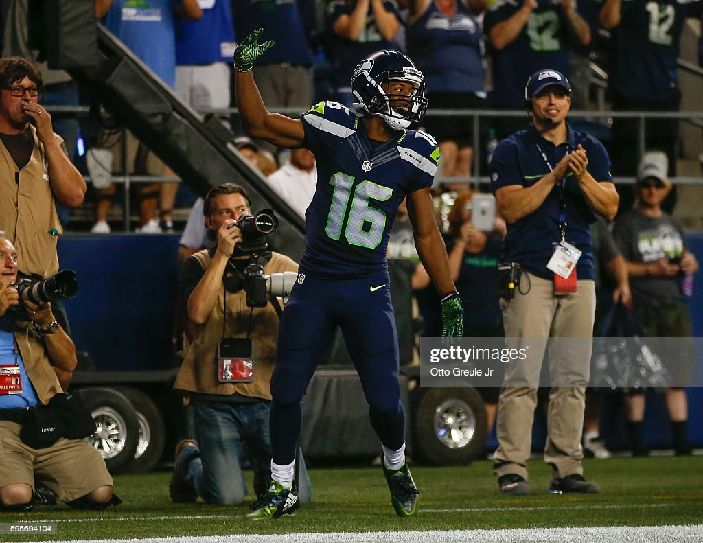 Wide receiver Tyler Lockett #16 of the Seattle Seahawks celebrates after scoring a touchdown in the third quarter against the Dallas Cowboys at CenturyLink Field on August 25, 2016 in Seattle, Washington. The Seahawks defeated the Cowboys 27-17.
