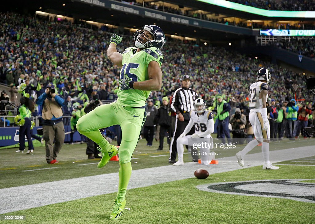 Wide receiver Tyler Lockett #16 of the Seattle Seahawks celebrates after scoring a touchdown against the Los Angeles Rams at CenturyLink Field on December 15, 2016 in Seattle, Washington.