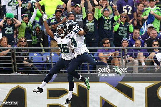 Wide receiver Tyler Lockett of the Seattle Seahawks celebrates with teammate wide receiver Doug Baldwin after scoring a fourth quarter touchdown...