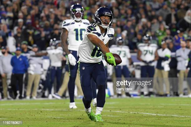 Wide receiver Tyler Lockett of the Seattle Seahawks gestures to the spot of the catch but short of the first down in the second quarter of the game...