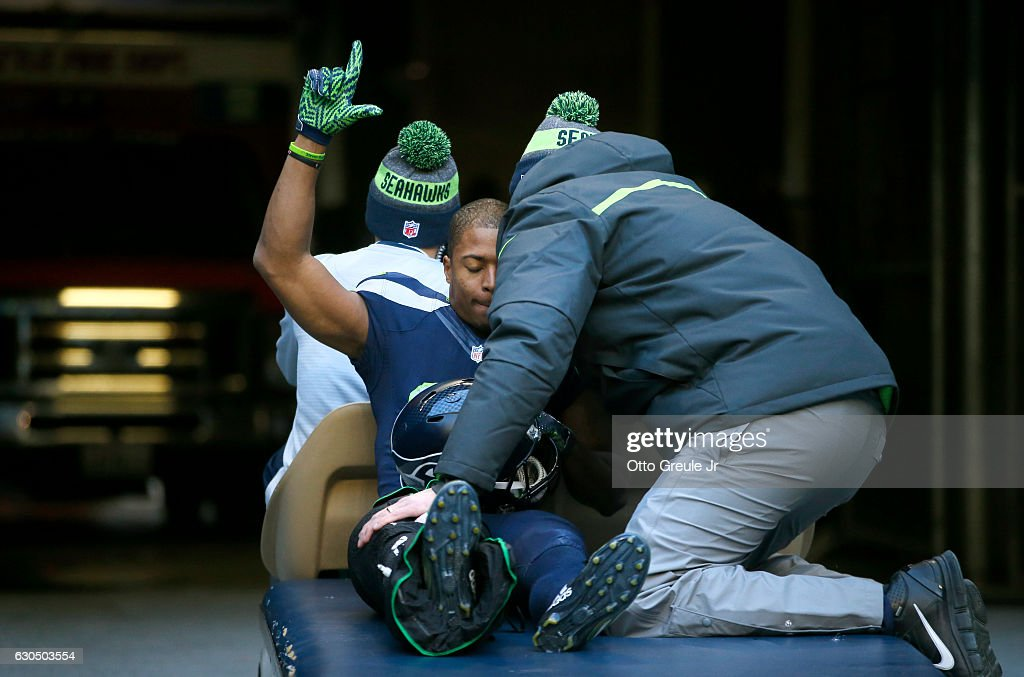Wide receiver Tyler Lockett #16 of the Seattle Seahawks gestures to the crowd as he leaves the game after getting injured in a play against the Arizona Cardinals at CenturyLink Field on December 24, 2016 in Seattle, Washington.