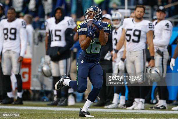 Wide receiver Tyler Lockett of the Seattle Seahawks makes a catch for a 63 yard touchdown in the first quarter against the Oakland Raiders at...