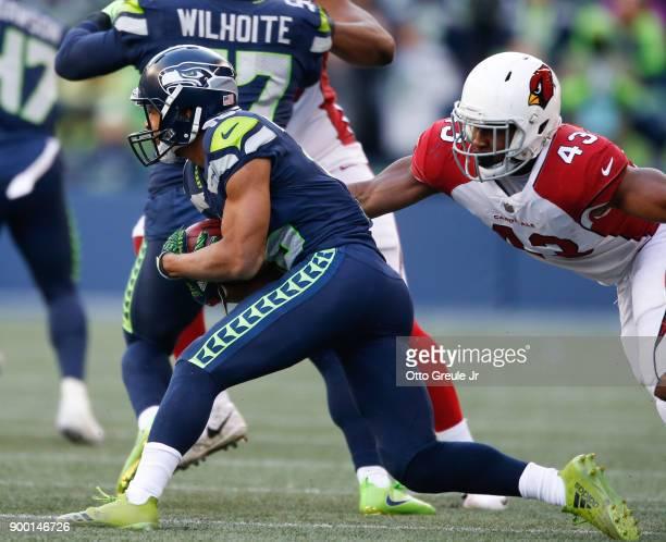 Wide receiver Tyler Lockett of the Seattle Seahawks rushes against inside linebacker Haason Reddick of the Arizona Cardinals at CenturyLink Field on...