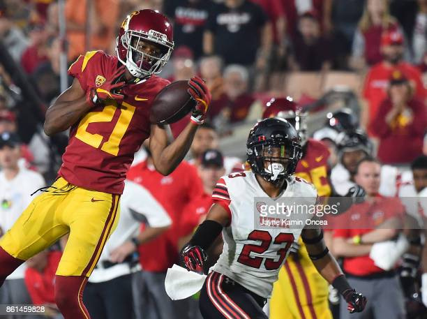 Wide receiver Tyler Vaughns of the USC Trojans gets in front of defensive back Julian Blackmon of the Utah Utes as he catches the ball on the 17 yard...