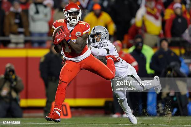 Wide receiver Tyreek Hill of the Kansas City Chiefs catches a pass on his way to a touchdown in front of cornerback David Amerson of the Oakland...