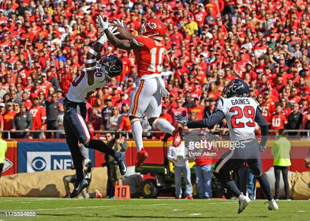 Wide receiver Tyreek Hill of the Kansas City Chiefs catches a touchdown pass between defenders Justin Reid and cornerback Phillip Gaines of the...
