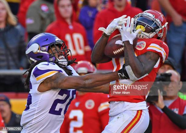 Wide receiver Tyreek Hill of the Kansas City Chiefs catches a pass against cornerback Trae Waynes of the Minnesota Vikings during the second half...