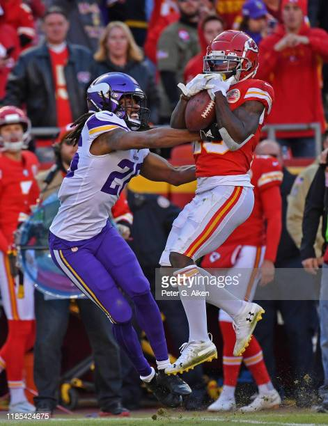 Wide receiver Tyreek Hill of the Kansas City Chiefs catches a pass against cornerback Trae Waynes of the Minnesota Vikings during the second half at...