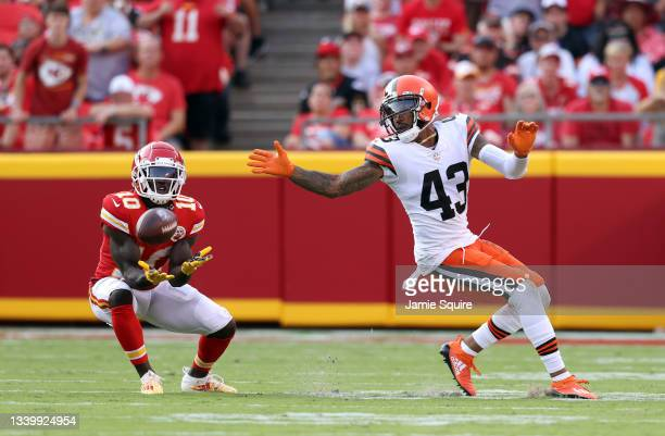 Wide receiver Tyreek Hill of the Kansas City Chiefs catches a pass then carries the ball for a touchdown as strong safety John Johnson of the...