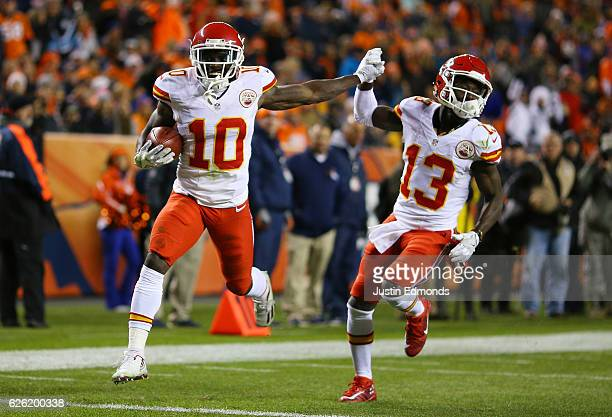 Wide receiver Tyreek Hill of the Kansas City Chiefs celebrates with De'Anthony Thomas after returning a kickoff for a touchdown in the second quarter...