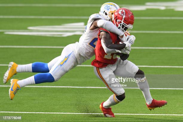Wide receiver Tyreek Hill of the Kansas City Chiefs is tackled by defensive back Desmond King of the Los Angeles Chargers during overtime at SoFi...