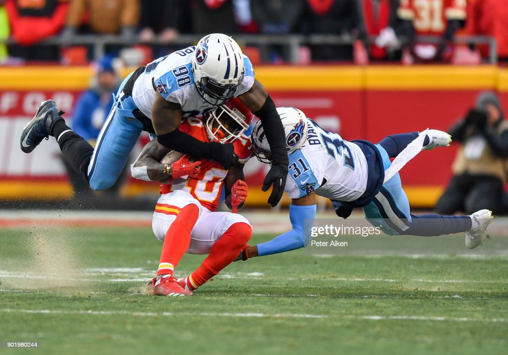 Wide receiver Tyreek Hill #10 of the Kansas City Chiefs is tackled by outside linebacker Brian Orakpo #98 and free safety Kevin Byard #31 of the Tennessee Titans during the first half of the AFC Wild Card Playoff Game at Arrowhead Stadium on January 6, 2018 in Kansas City, Missouri.
