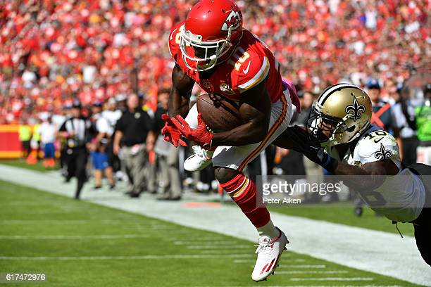 Wide receiver Tyreek Hill of the Kansas City Chiefs leaps and catches a touchdown pass over cornerback Ken Crawley of the New Orleans Saints at...