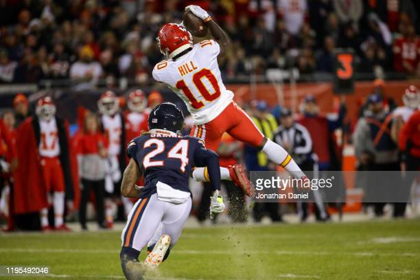 Wide receiver Tyreek Hill of the Kansas City Chiefs makes a first-down catch against cornerback Buster Skrine of the Chicago Bears in the first...