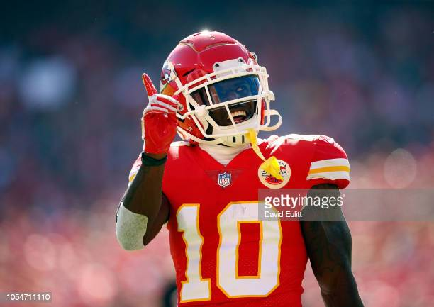 Wide receiver Tyreek Hill of the Kansas City Chiefs reacts after catching a pass during the game against the Denver Broncos at Arrowhead Stadium on...