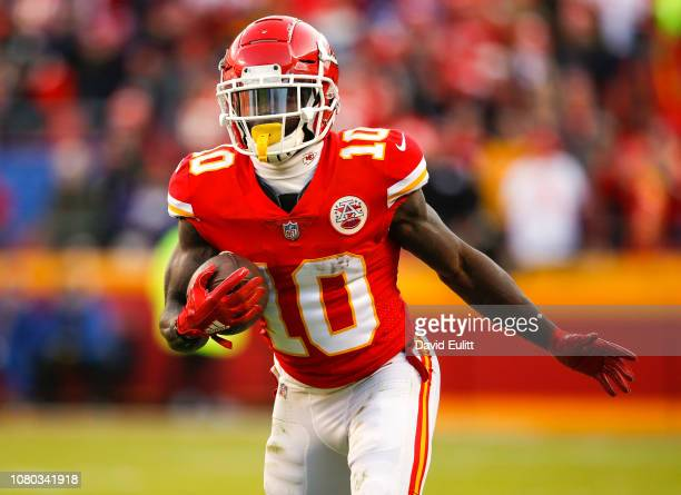 Wide receiver Tyreek Hill of the Kansas City Chiefs runs after a fourth quarter pass catch against the Baltimore Ravens at Arrowhead Stadium on...