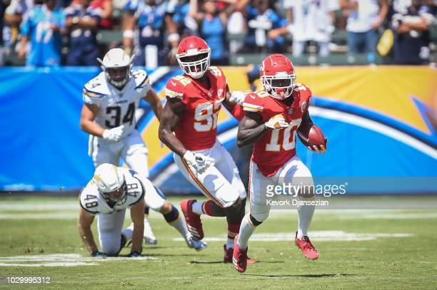 Wide receiver Tyreek Hill of the Kansas City Chiefs runs the ball for a touchdown in the first quarter against the Los Angeles Chargers at StubHub...