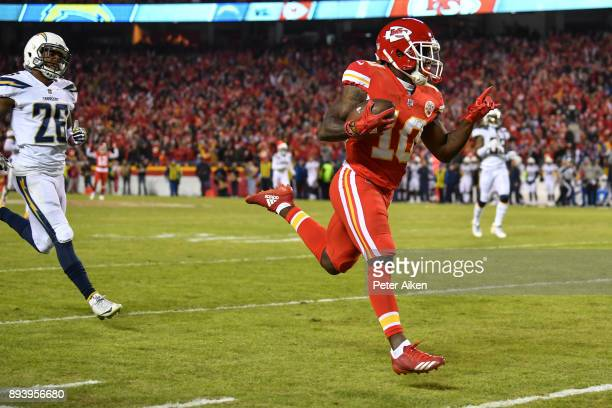 Wide receiver Tyreek Hill of the Kansas City Chiefs runs to the end zone after a catch against the Los Angeles Chargers at Arrowhead Stadium on...