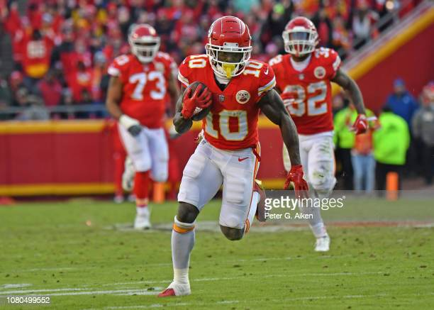 Wide receiver Tyreek Hill of the Kansas City Chiefs turns up field after catching a pass on a fourth down play late in the second half against the...