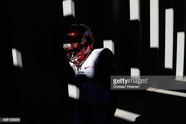 Wide receiver Tyrell Johnson of the Arizona Wildcats walks out onto the field before the college football game against the Arizona State Sun Devils...