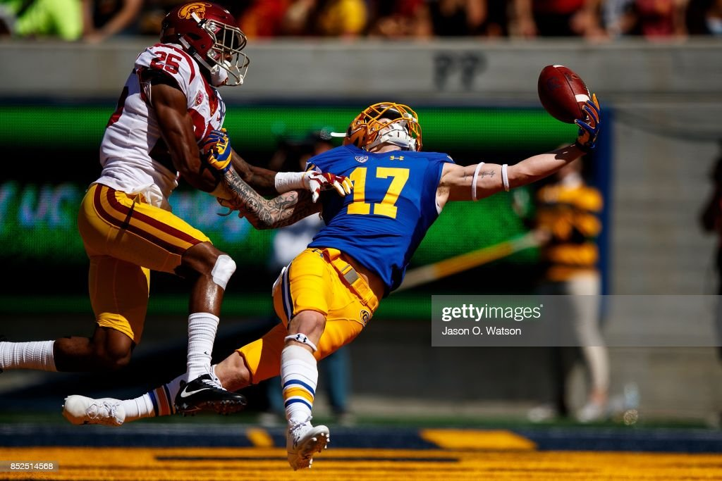 Wide receiver Vic Wharton III #17 of the California Golden Bears reaches for but is unable to catch a pass in the end zone in front of cornerback Jack Jones #25 of the USC Trojans during the first quarter at California Memorial Stadium on September 23, 2017 in Berkeley, California.