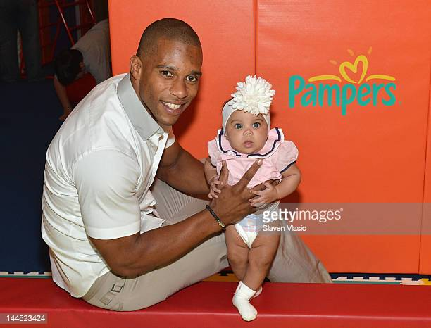 NFL wide receiver Victor Cruz and daughter Kennedy Cruz attend Pampers Spirit of Play Event In Celebration Of The London 2012 Olympicson May 14 2012...
