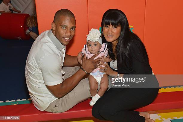 NFL wide receiver Victor Cruz daughter Kennedy Cruz and girlfriend Elaina Watley attend Pampers Spirit of Play Event In Celebration Of The London...
