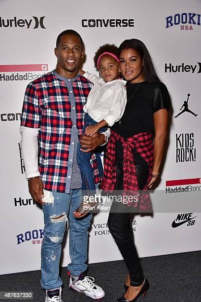 NFL wide receiver Victor Cruz daughter Kennedy Cruz and wife Elaina Watley attend Kids Rock during New York Fashion Week at The Dock Skylight at...