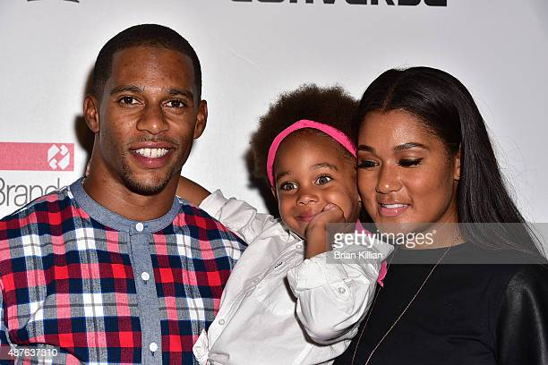 NFL wide receiver Victor Cruz daughter Kennedy Cruz and wife Elaina Watley attend the Kids Rock show during New York Fashion Week at The Dock...