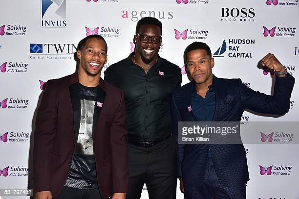 NFL wide receiver Victor Cruz NFL defensive end Jason PierrePaul and recording artist Maxwell attend the 7th Annual Solving Kids' Cancer Spring...