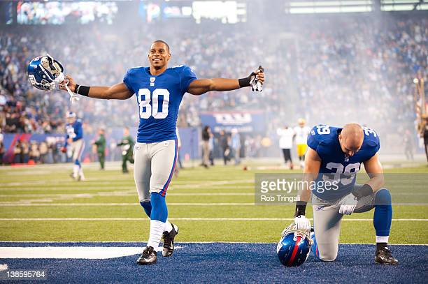 Wide receiver Victor Cruz of the New York Giants and Tyler Sash gesture to the crowd before the game against the New York Giants at MetLife Stadium...