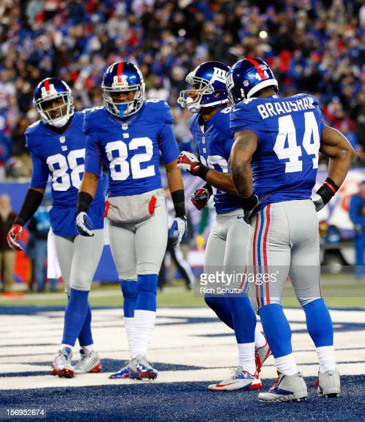 Wide receiver Victor Cruz of the New York Giants celebrates with a salsa dance after scoring a touchdown in the second quarter as his teammates...