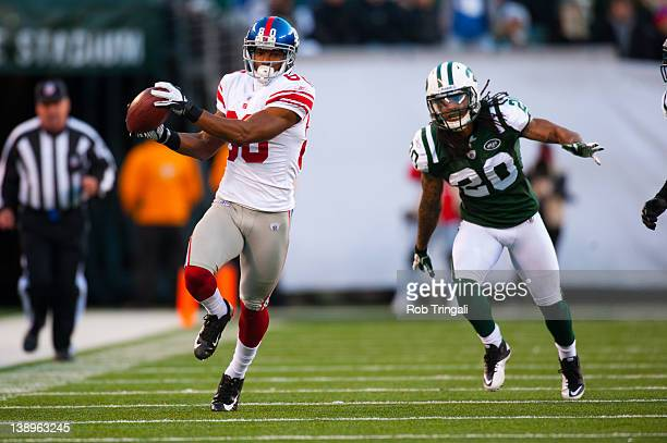 Wide receiver Victor Cruz of the New York Giants runs the ball during the game against the New York Jets at MetLife Stadium on December 24, 2011 in...