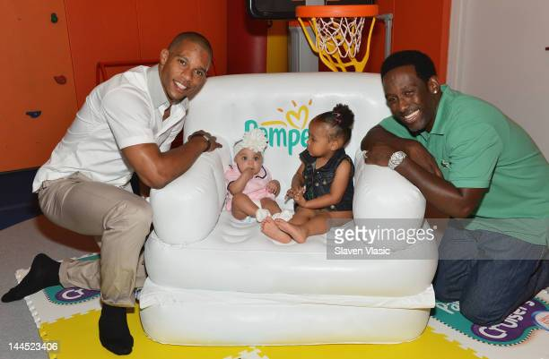 NFL wide receiver Victor Cruz with daughter Kennedy Cruz and Shawn Stockman of Boyz II Men with his daughter Brooklyn Stockman attend Pampers Spirit...
