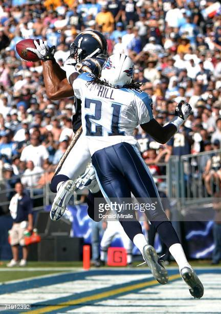 Wide receiver Vincent Jackson of the San Diego Chargers catches a 12-yard touchdown pass under pressure from Reynaldo Hill of the Tennessee Titans...