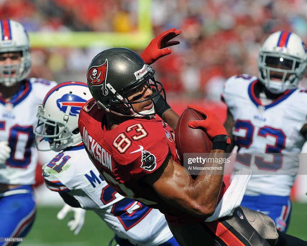 Wide receiver Vincent Jackson #83 of the Tampa Bay Buccaneers catches a 1st-quarter pass at midfield against the Buffalo Bills December 8, 2013 at Raymond James Stadium in Tampa, Florida.