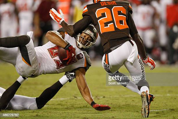 Wide receiver Vincent Jackson of the Tampa Bay Buccaneers catches in the ball in front of cornerback Pierre Desir of the Cleveland Browns during the...