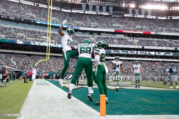 Wide Receiver Vyncint Smith of the New York Jets celebrates with offensive tackle Kelvin Beachum after a touchdown in the second half against the...