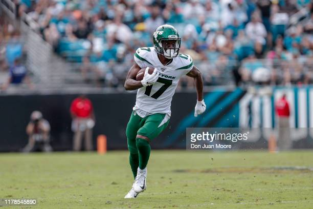 Wide receiver Vyncint Smith of the New York Jets runs after a catch during the game against the Jacksonville Jaguars at TIAA Bank Field on October 27...
