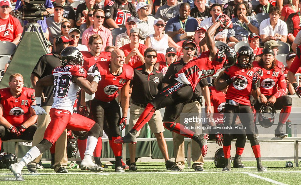 Wide receiver Wallace Miles #84 of the Ottawa Redblacks makes a catch along the sidelines against defensive back Buddy Jackson #38 of the Calgary Stampeders during a CFL game at TD Place Stadium on August 24, 2014 in Ottawa, Ontario, Canada.