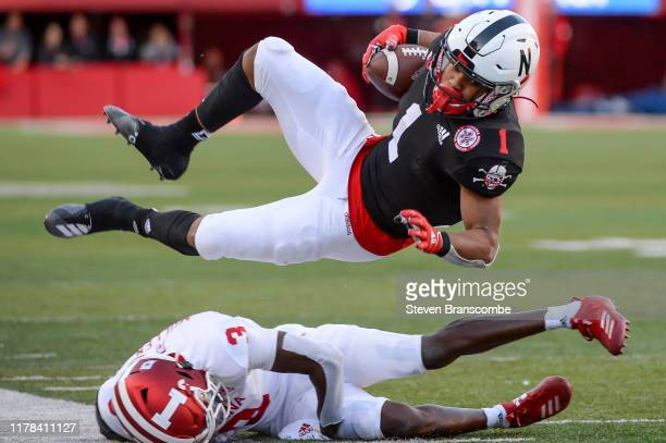 Wide receiver Wan'Dale Robinson of the Nebraska Cornhuskers goes air born after a tackle from defensive back Tiawan Mullen of the Indiana Hoosiers at...