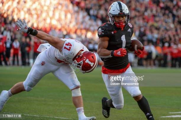 Wide receiver Wan'Dale Robinson of the Nebraska Cornhuskers scores against linebacker Micah McFadden of the Indiana Hoosiers at Memorial Stadium on...