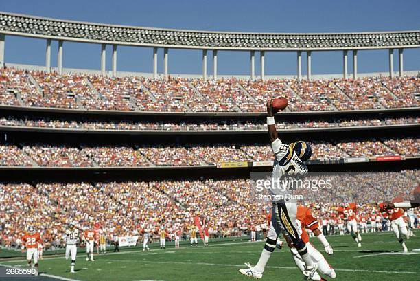 Wide receiver Wes Chandler of the San Diego Chargers reaches for a pass at the endzone during a 1987 NFL game against the Denver Broncos at Jack...