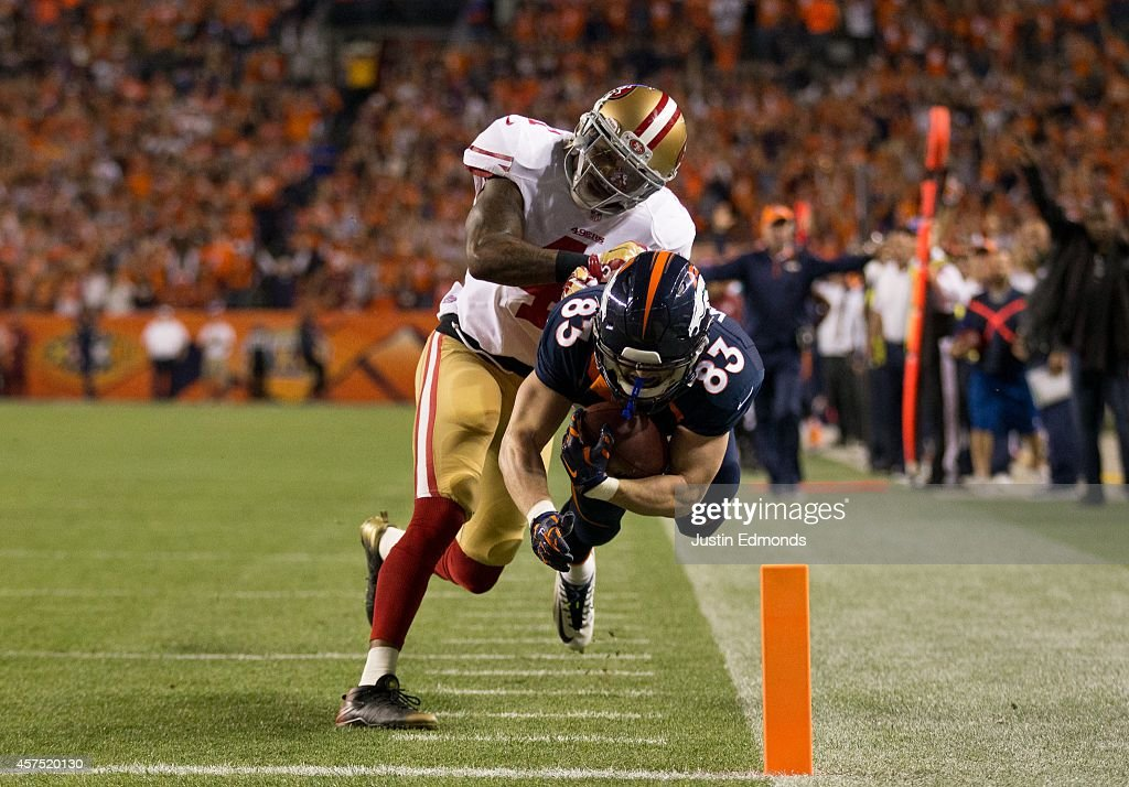 Wide receiver Wes Welker #83 of the Denver Broncos is forced out of bounds at the goal line by strong safety Antoine Bethea #41 of the San Francisco 49ers on a 39 yard touchdown catch at Sports Authority Field at Mile High on October 19, 2014 in Denver, Colorado.